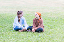 Two Girls Sitting on Grass Royalty Free Stock Image