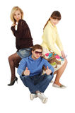 Two Girls Sitting On A Guy S Back Royalty Free Stock Image