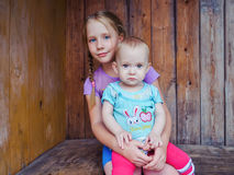 Two girls sitting together royalty free stock photos