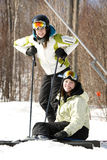 Two girls on ski slopes Royalty Free Stock Image