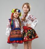 Two girls in  Slavic folk costumes Royalty Free Stock Photos