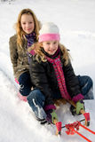 Two girls on a sled Stock Image