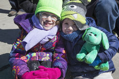 Two girls smile, St. Patrick's Day Parade, 2014, South Boston, Massachusetts, USA Royalty Free Stock Photo