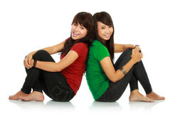 Two girls smiling. Portrait of attractive two girls smiling to the camera on white background Stock Photos
