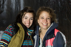 Two girls smiling and hanging out Stock Images