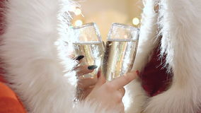 Two girls in snow maiden suit holds bocals of champagne in the middle. Slowly stock footage
