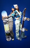 Two girls with snowboards Royalty Free Stock Image