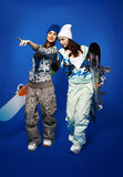 Two girls with snowboards Stock Photos
