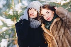 Two girls in a snowy forest Stock Images