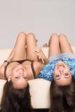 Two girls at sofa Stock Image