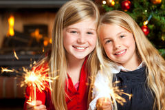 Two girls with sparklers. Smiling Royalty Free Stock Photos