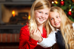 Two girls with sparklers Royalty Free Stock Images