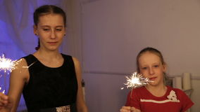 Two girls with sparklers stock video
