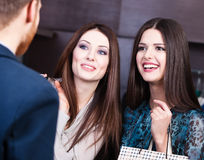 Two girls speak about discounts Stock Photo