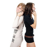Two girls speak on the phone Stock Photos