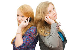 Two girls speaking by phone Royalty Free Stock Photography