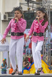 Two girls on stage singing a song Royalty Free Stock Image