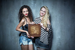 Two girls standing on the background of textured walls  Royalty Free Stock Photography