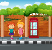 Two girls standing at the pavement Stock Photo