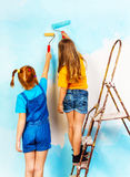 Two girls standing together on a ledge Stock Image