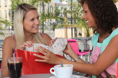 Two girls stopping for coffee Royalty Free Stock Image