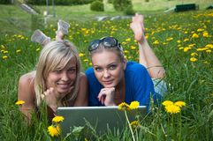 Two girls student with a laptop Stock Images