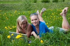 Two girls student with a laptop Royalty Free Stock Image