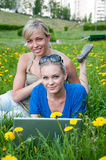 Two girls student with a laptop Royalty Free Stock Images