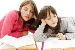 Two girls students studying on the floor Royalty Free Stock Image