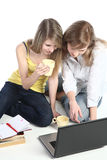 Two girls-students work on the laptop. Stock Photography