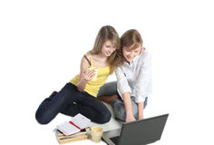 Two girls-students work on the laptop. Royalty Free Stock Photos