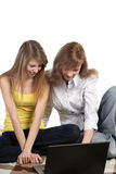 Two girls-students work on the laptop. Royalty Free Stock Images