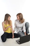 Two girls-students work on the laptop. Royalty Free Stock Photography