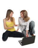 Two girls-students work on the laptop. Royalty Free Stock Image