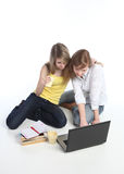 Two girls-students work on the laptop. Stock Images