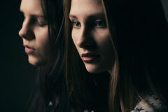 Two girls studio portrait Royalty Free Stock Images