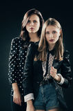 Two girls studio portrait Royalty Free Stock Image