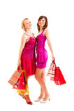 Two girls after successful shopping Royalty Free Stock Photography