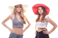 Two girls in summer hats. Studio photography Stock Photo