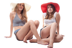 Two girls in summer hats. Studio photography Royalty Free Stock Photography