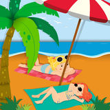 Two girls sunbathing on the beach Royalty Free Stock Image