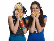 Two girls with sweet pepper Stock Image