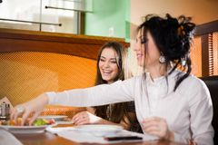 Two girls at table Stock Photography