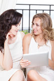 Two girls with tablet pc Stock Images