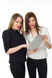 Two Girls with tablet. Two smiling girls with tablet, isolated on white Stock Images