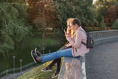 Two girls take photo of their feet on the phone Royalty Free Stock Photo