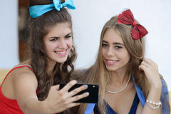 Two girls take pictures on your phone Royalty Free Stock Image