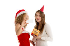 Two girls take selfie in cristmas costumes Royalty Free Stock Photography