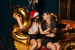 Two girls takes Christmas selfie on smart phone stock photos