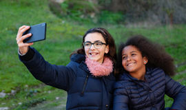 Two girls taking a photo with the mobile Stock Photos